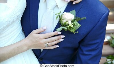 couple embracing on wedding day, close-up