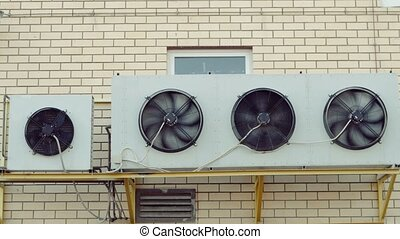 A wall mounted industrial heating and cooling system of mall...