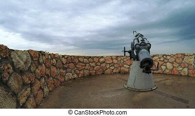 Manual lowering of artillery gun barrel
