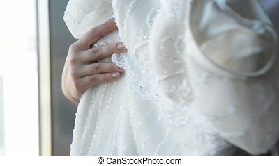 Romantic Wedding Concept Bride Holding wedding dress in a...