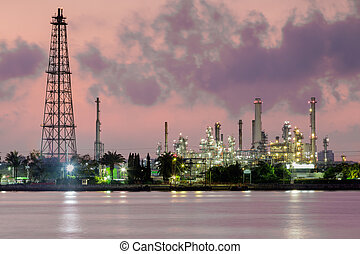 Twilight Oil refinery river front