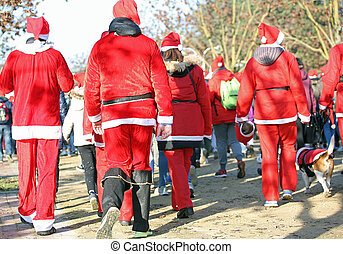 people run in the public park of the city at Christmas -...