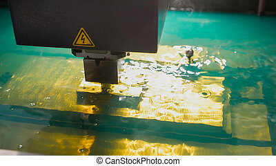 Cutting of sheet metal process in water. Sparks fly from...