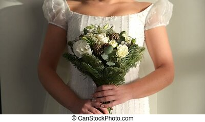 Romantic Wedding Concept Bride Holding flowers indoor