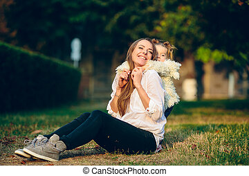 Mother and little daughter in a park