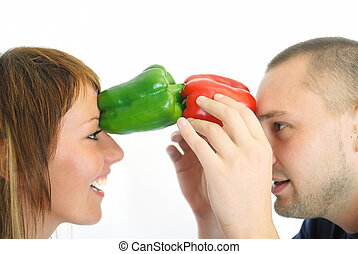 happy couple holding peppers with head - happy couple with...