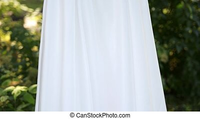 wedding dress outdoor - beautiful wedding dresses hanging...