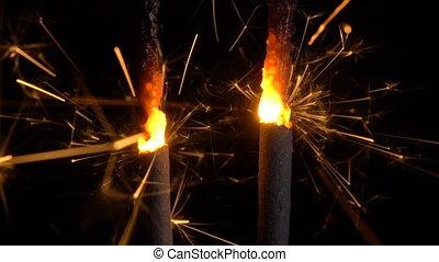 Burning sparklers in the dark