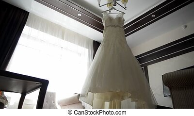 beautiful wedding dresses in a hotel room - Dolly shot:...