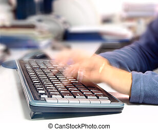 Woman writing quickly on a computer keyboard