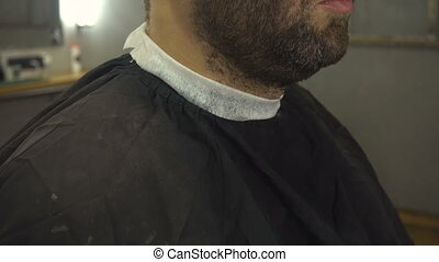 Shaving beard of man in barber shop - Shaving beard of man...