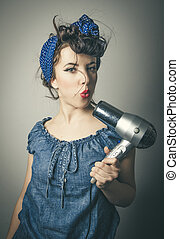 Housewife in vintage clothes with hair dryer - Half body...