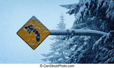 Road Sign In Heavy Snowfall - Road sign by trees in winter...
