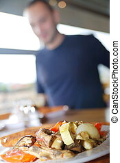 man eating healthy food it an restaurant - man eating...