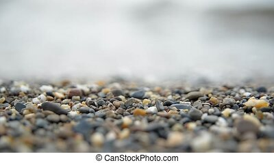 Amber on a beach close-up - Amber on a beach of the sea,...