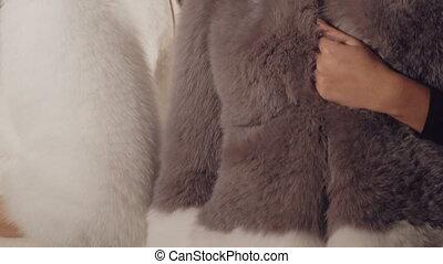 Two models posing in rich fur coats in boutique in full HD