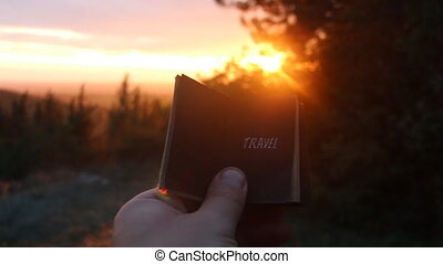 Travel idea - Book with the text. Sunset. - Book with the...