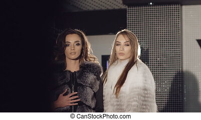 Two rich girls posing and catwalking in fur coats in full HD