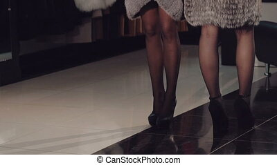 Two rich ladies posing and catwalk in fur coats - Two rich...
