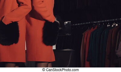 Glamour girls in red fur coats flirting and posing in...