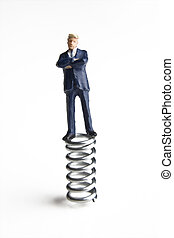 The business bounce - Businessman figurine standing on a...