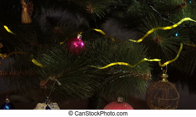 beautiful green Christmas tree with toys and Garland on it