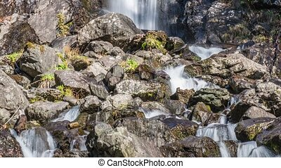 Waterfall flowing over a cliff. Abkhazia - Beautiful...