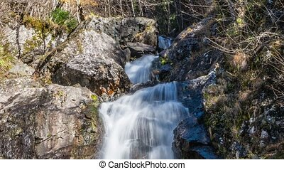 Waterfall flowing over a cliff. Abkhazia