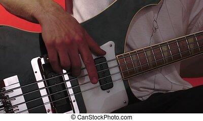 Music group in club. Guitarist close-up, HD