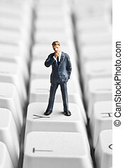 Technology for small business - Businessman figurine placed...
