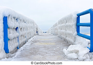 ice on Lake Michigan pier - ice formation on blue railing on...