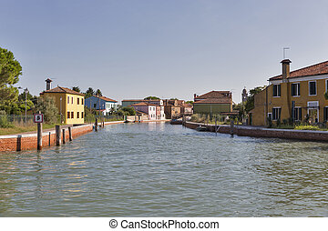 Burano cityscape with canal, Venice, Italy.