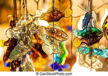 Small decorative glass fishes in a thread - Small decorative...
