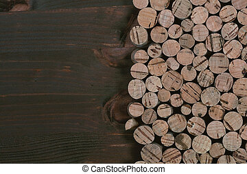 cork on a wooden background, room for text. Bottle caps