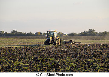 Tractor plowing plow the field. Tilling the soil in the fall...