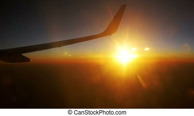Passenger Plane in Flight Against a Background of Sunset