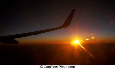 Sunset Sky form the Airplane Window - Wing plane flying in...