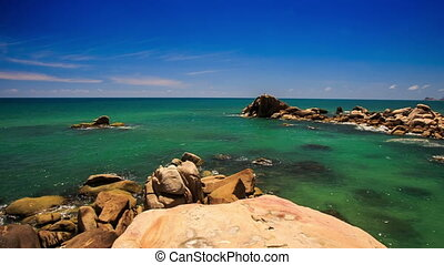 View Round Rock Stony Beach Azure Sea Skyline - camera moves...