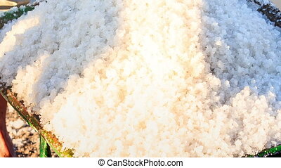 Closeup Basket Filled with White Salt under Sunlight -...