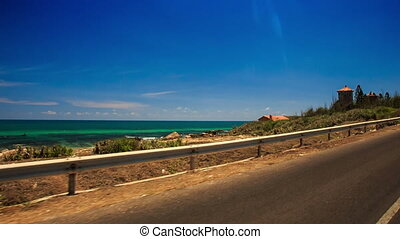 Camera Moves along Asphalt Road by Azure Sea - camera moves...