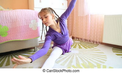 Young ballerina exercising time lapse - Young ballerina girl...