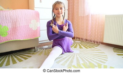 Young ballerina exercising - Young ballerina girl doing...