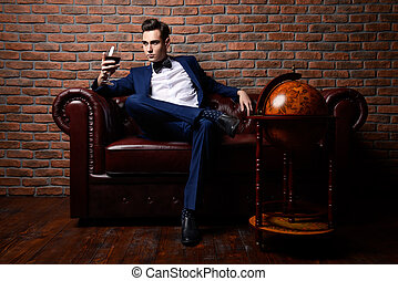 loft style - Imposing well dressed man in a luxurious...
