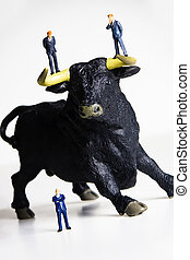 Bull market - Business figurines placed on a bull figurine.
