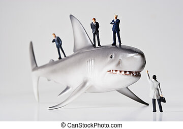 Sharks in the business world - Business figurines placed...