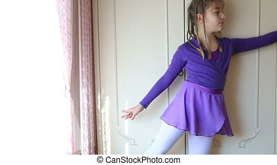 Young ballerina studying ballet - Graceful girl practicing...