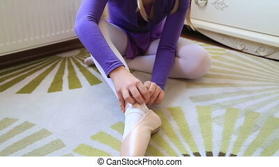 Young ballerina wearing pointe shoes - Adorable young girl...