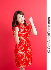 beauty woman wear cheongsam and feel excited with chinese...