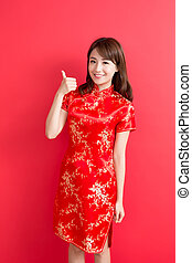 beauty woman wear cheongsam and thumb up with chinese new...