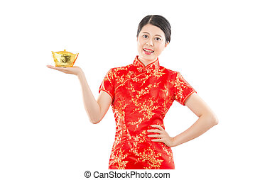 happy woman presenting golden ingot for chinese new year...